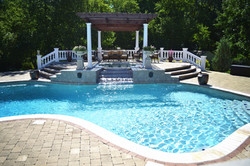 Pool with spa overflow