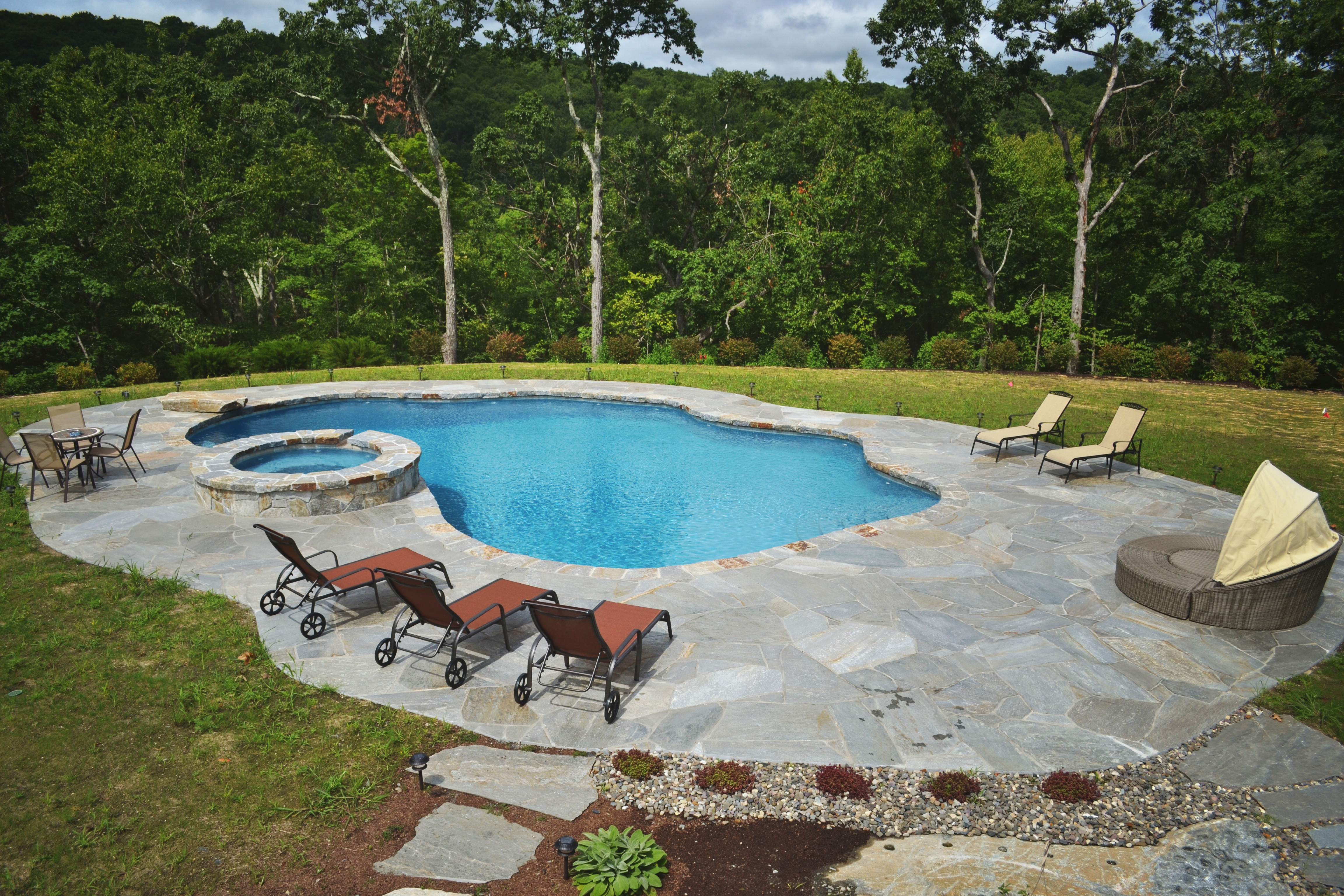 Pool with raised spillover spa