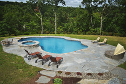 Pool with raised spa with overflow
