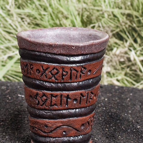 Viking mini shot glass with carved runes description that says the drink is good