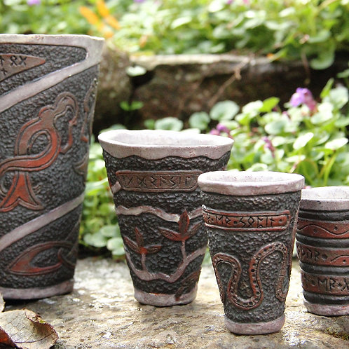 Set of four Ceramic Viking Cups and a Mug with carved pattern