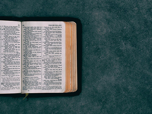 A Bible opened to the Psalms.