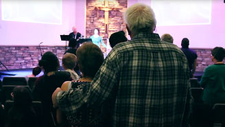 Church members hold each other at a Life Spring Community Church service.