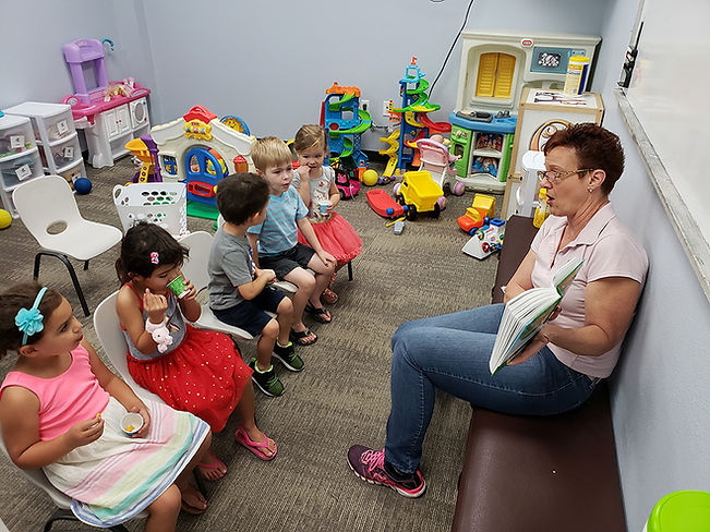 A group of children read during Children's Ministry