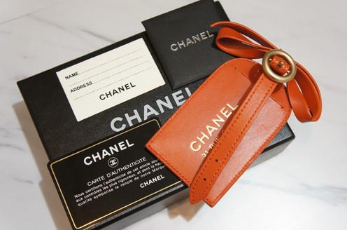 81c48be67262 WUGMUG- Chanel Orange Leather Luggage Tag with Ribbon