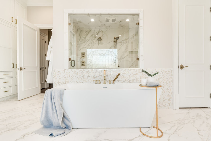White bathroom, custom white cabinets, bathtub, gold hardware, gold faucet, custom cabinets, Dove St