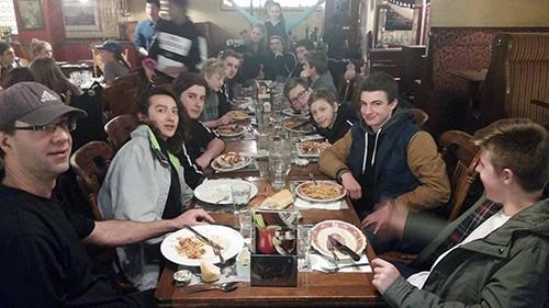 The slightly less photogenic boys pose during team dinner.