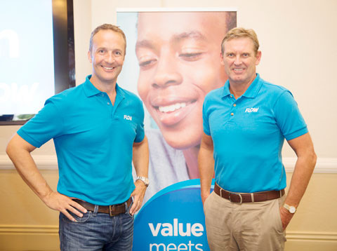 Flow chief executive officer Bill McCabe, left, with Phil Bentley, chief executive of Cable & Wireless Communications, as they celebrate the launch of the new Flow brand in Grand Cayman
