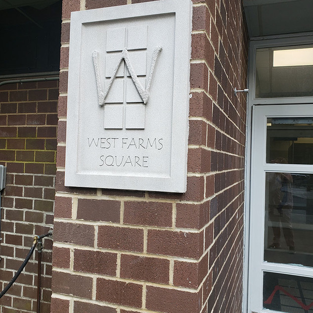 West Farms Square logo on building