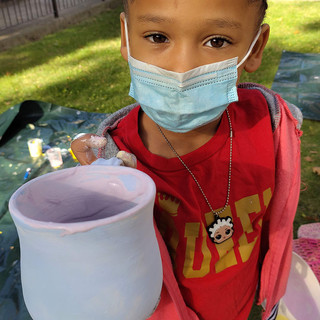 child with ceramic mug