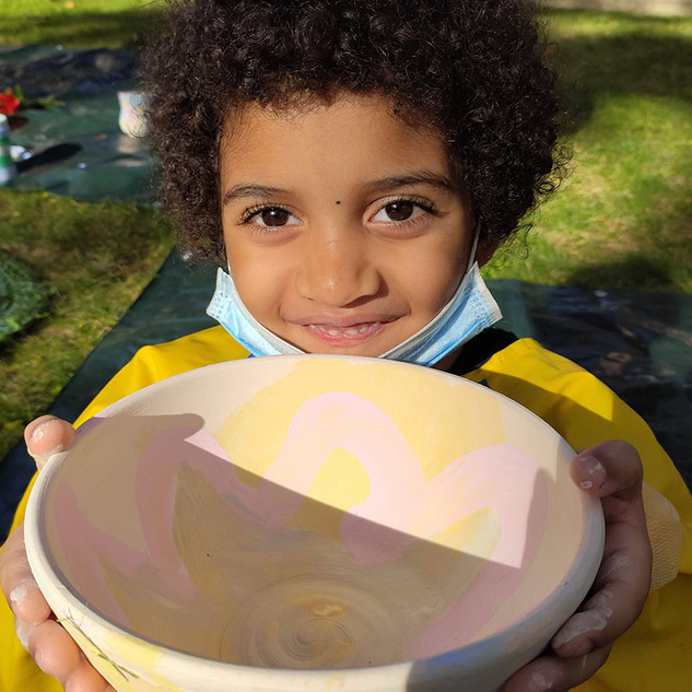 Child with ceramic bowl