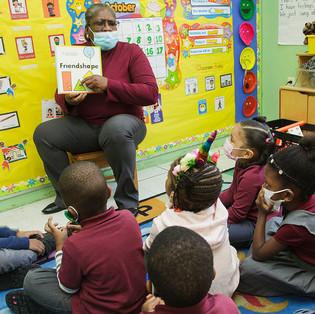 Teacher reading to group of children