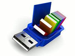 22970311-una-unidad-flash-usb-y-libros-s