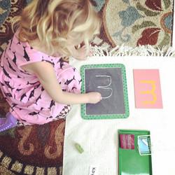 Writing letters on chalkboard