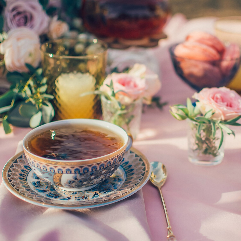 Image of a tea cup and high tea setting.