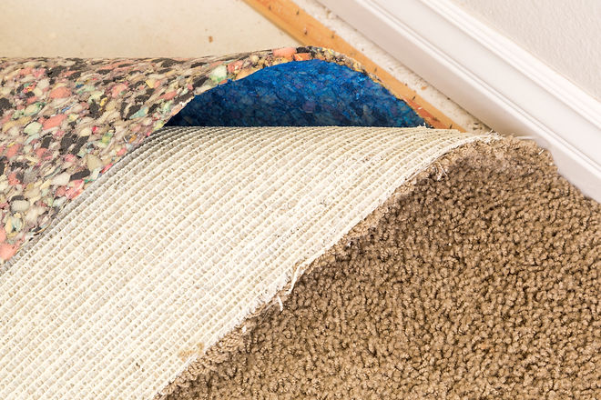 Pulled Back Carpet and Padding In Room of House..jpg
