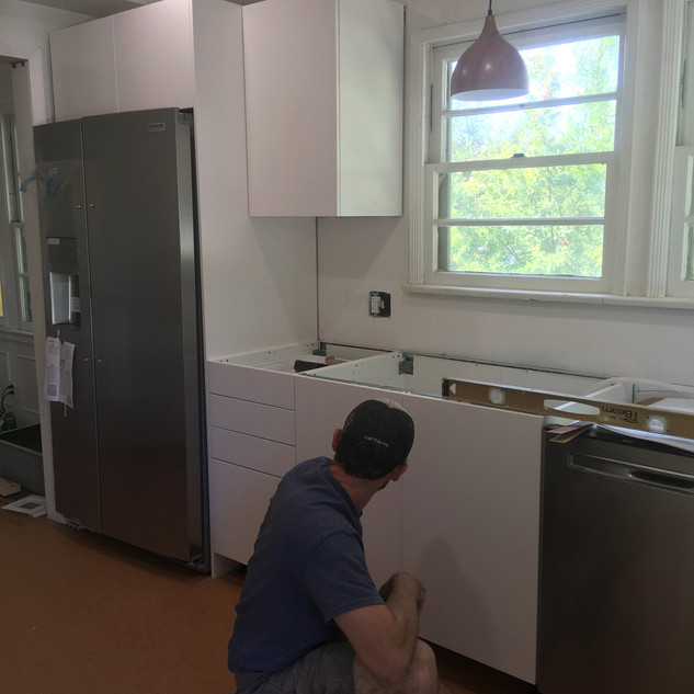 This cute bungelow home was in desperate need of a kitchen refresh.  We removed the old kitchen with tiled countertops, rearranged things a bit, and installed a new Ikea kitchen with new appliances and tiled backsplash.  #pennhandy #ikeakitchen #corkfloor #butcherblock