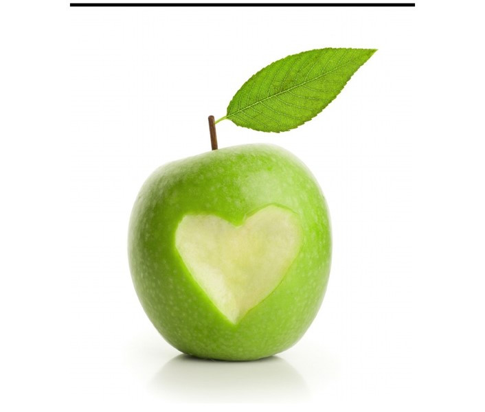 Green apple with heart cut out of it