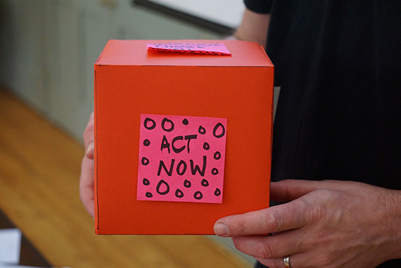 Box With Act Now Sticker On It