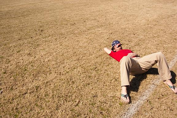 Guy Lying In Field