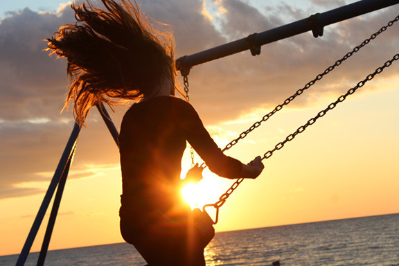 Woman Swinging at Sunset