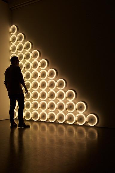 Man Looking At Circles With a Glow