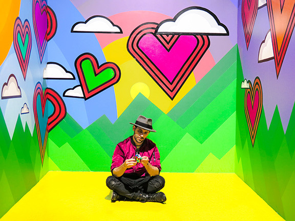 Man Sitting in Colorful Room