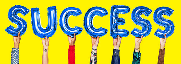 People Holding Letters That Spell Success