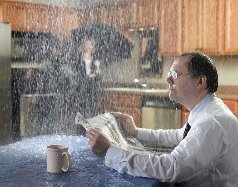 Man Drenched From Leaking Roof