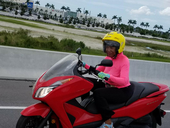Gina Greenlee on a Motorcycle
