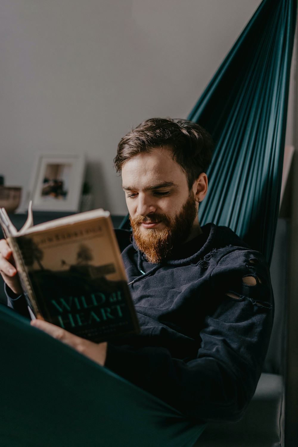 Man with beard reading book