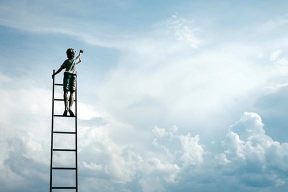 Boy Climbing Ladder To The Sky