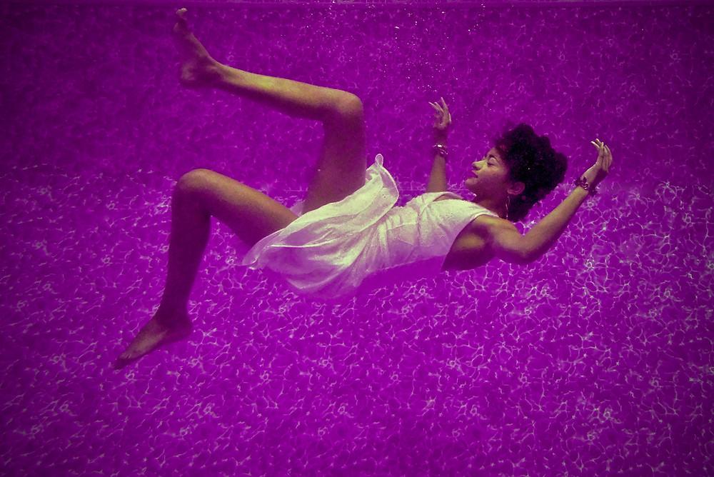 Woman dangling in mid-air