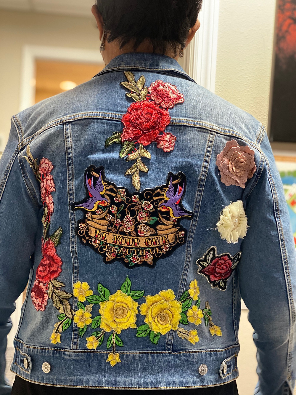 Artwork embroidery on back of jean jacket