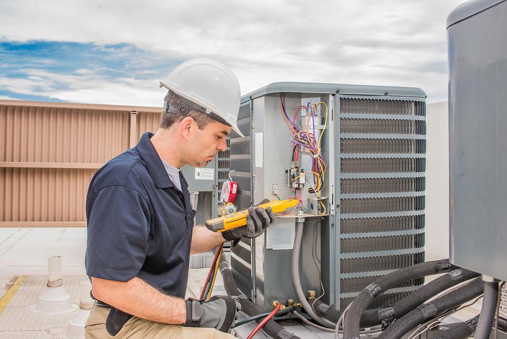 Man working on AC unit