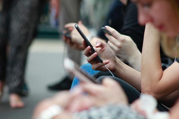 Multiple People on Mobile Phone