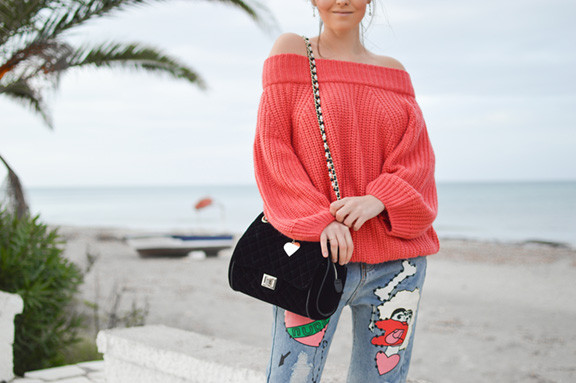 Woman with Tangerine Sweater and Black Purse