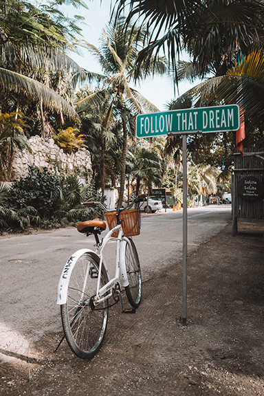 Bike in front of Follow Your Dream Sign