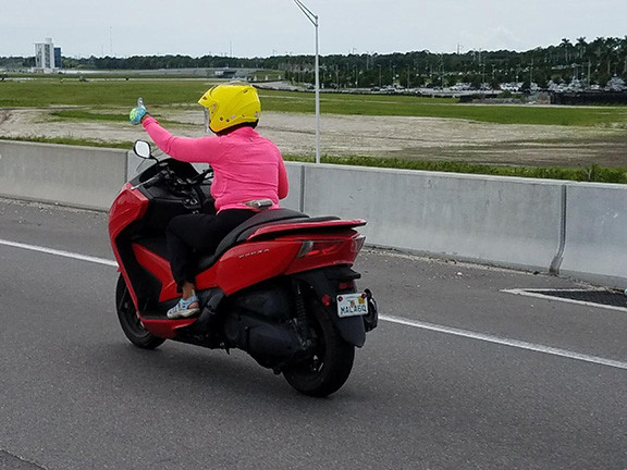 Gina Greenlee on a Motorcycle with Thumbs Up