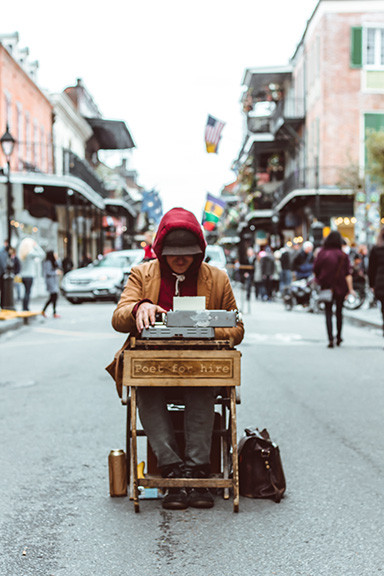 Man Typing on a typewriter in the middle of the street