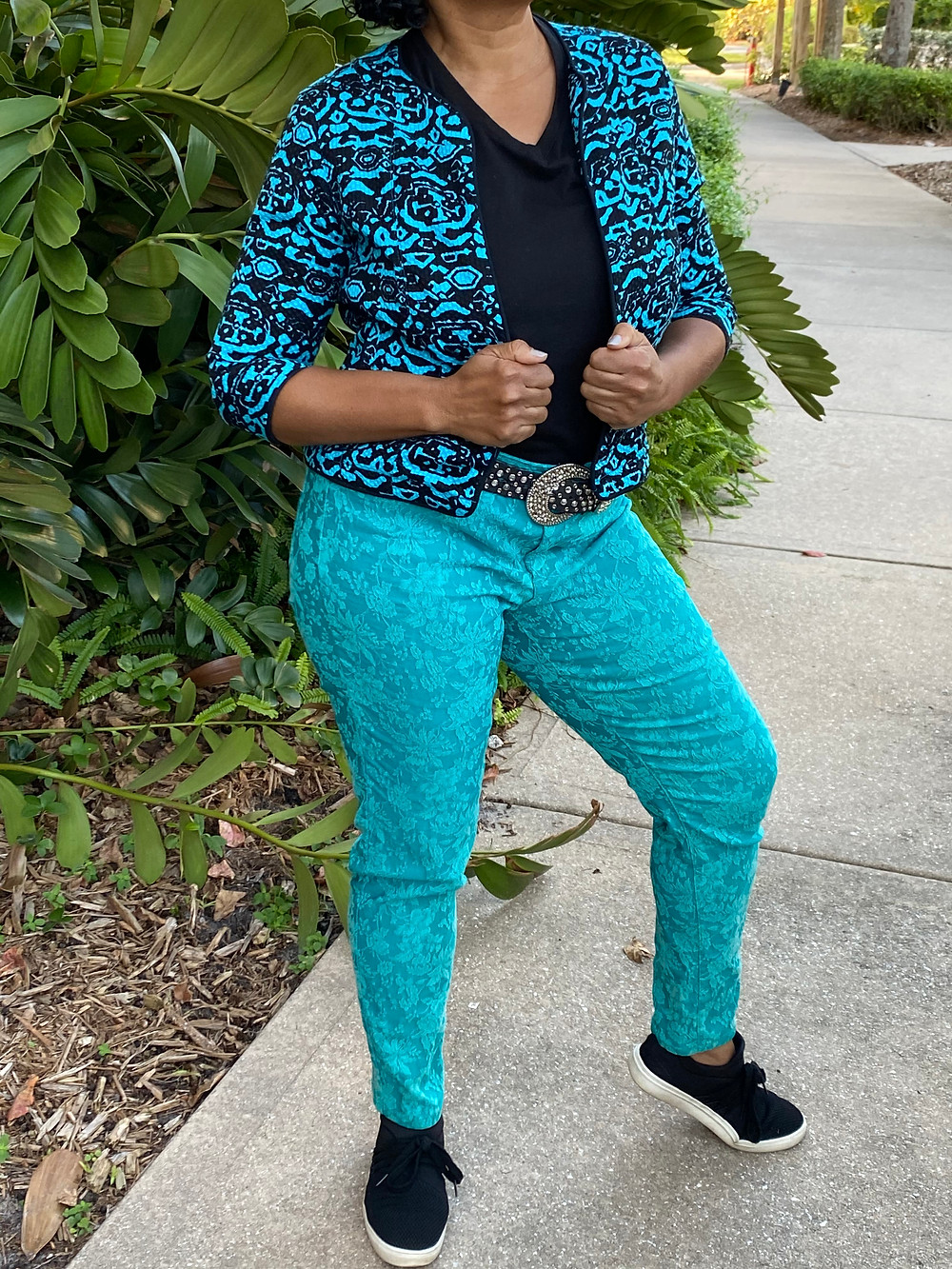 Woman wearing a turquoise pair of pants