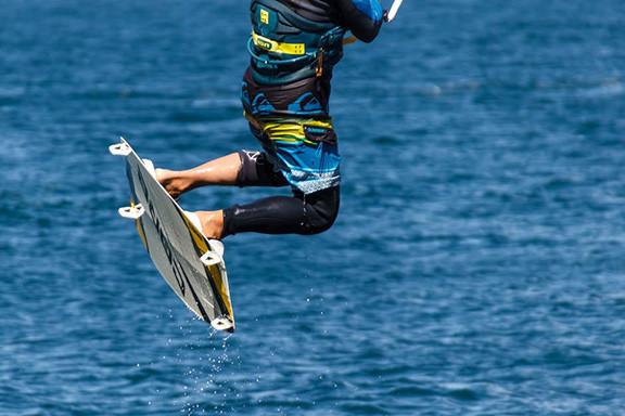 Man Kite Flying Over Water
