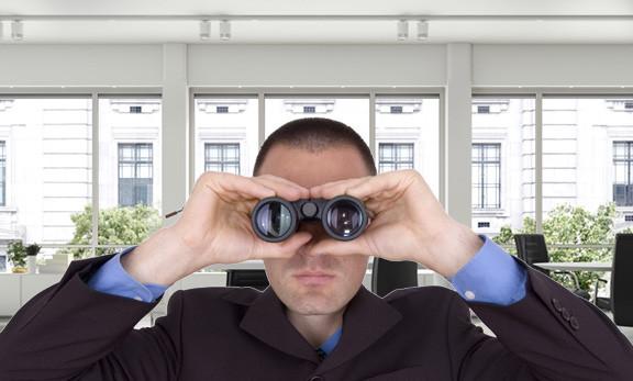 Man using Binoculars to find an SEO company
