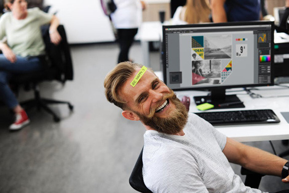 Man Laughing at Computer