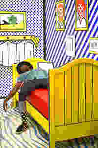 Graphic of a Man Laying In Colorful Bed