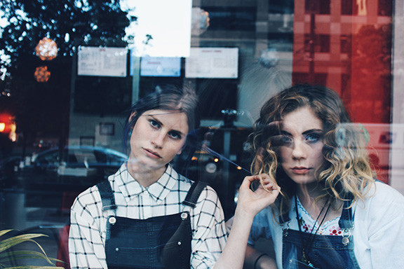 Two Bored Girls at Window