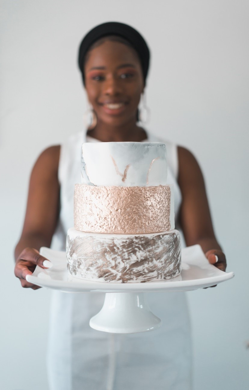 Black woman holding a cake