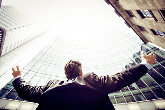 Businessman holding his arms up celebrating