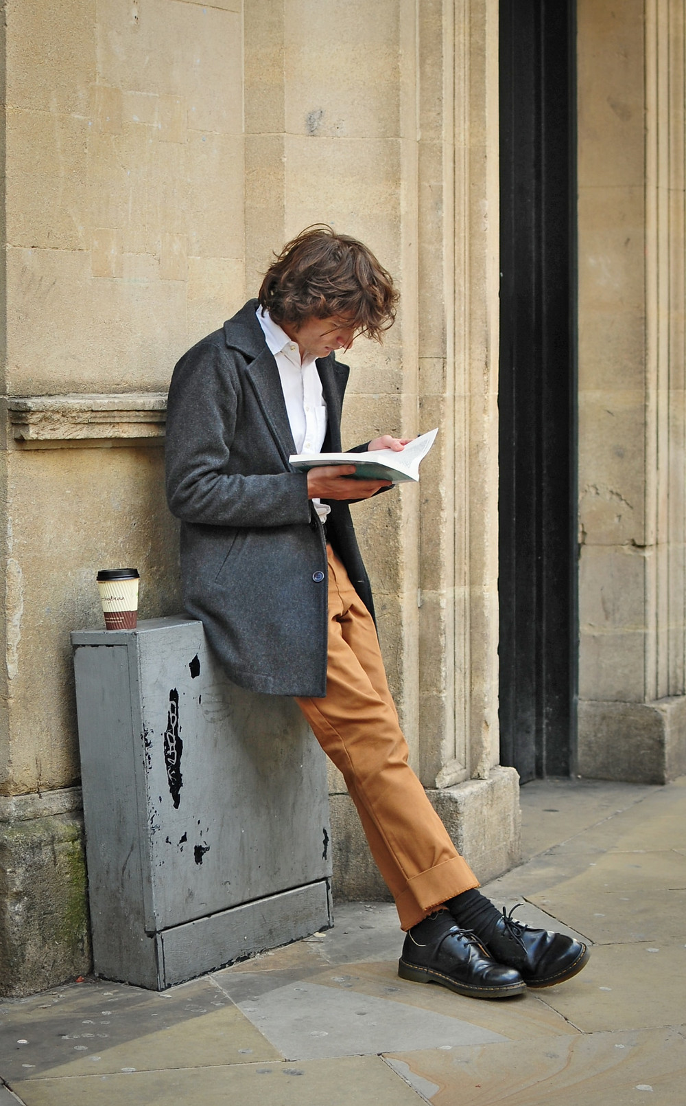 Man Reading on Street