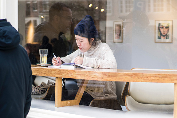 Asian Woman Writing